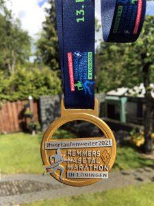 zum Bild:Die Teilnehmer-Medaille beim #wirlaufenweiter2021 - Remmers-Hasetal-Marathon des VfL Löningen.